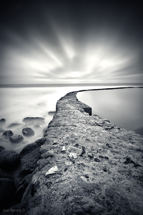 Long exposure black and white waterscape photography in Azenhas do Mar, Sintra Lisbon region, made by landscape photographer José Ramos from Portugal