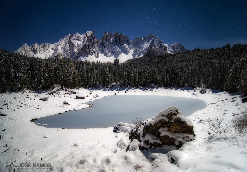 A long exposure made during the night, capturing the frozen Carezza Lake in the Dolomites (Italy). November 2017