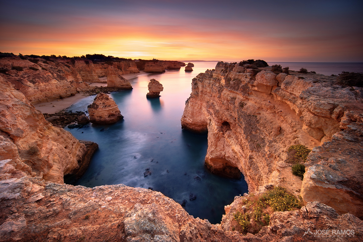 Long exposure waterscape photography shot during sunrise in Marinha Beach located in Algarve, Portugal